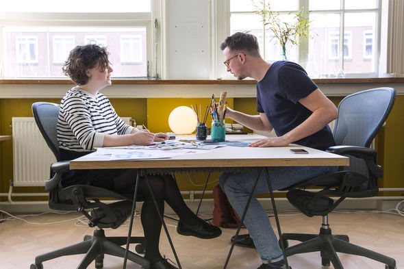 IMAGE: Photo – Jurjen and Ashley working at desk